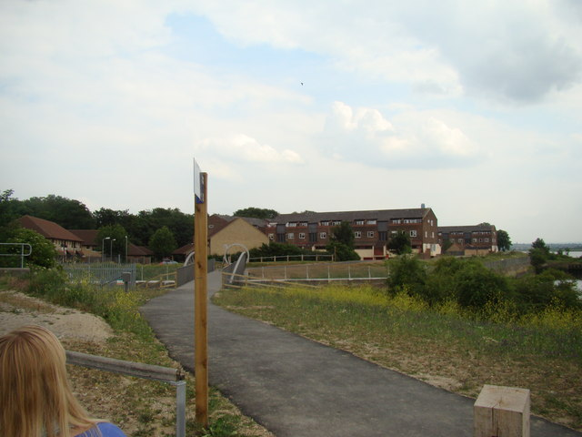 Houses on River Court, viewed from the path leading from the Rainham Marshes Nature Reserve Information Centre