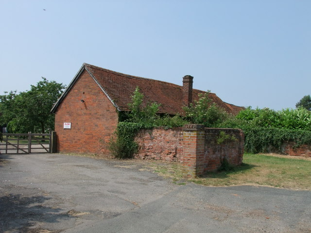 Farm buildings next to church in Mount Bures
