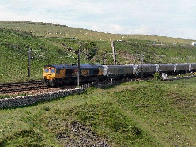A coal train runs along the East Coast Main Line