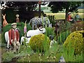 NT8937 : Shepherd and Sheep, The Cement Menagerie, Branxton by Andrew Curtis