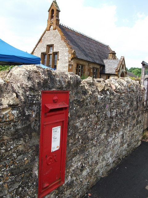 GR post box in wall adjacent to Combrook Village Hall