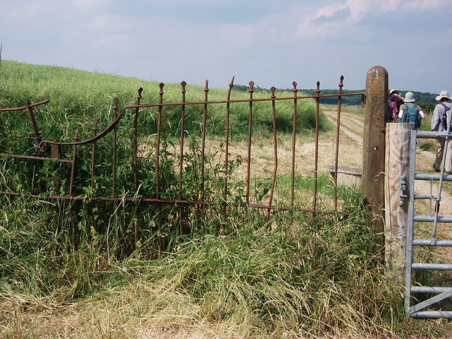 Old fence and gate post at edge of Compton Verney parkland