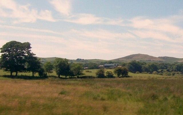 View across pastureland towards Bachellyn Farm, Penrhos