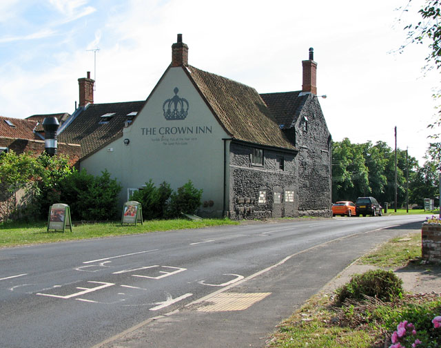The A148 road past the Crown Inn, East Rudham