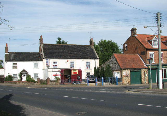 Junction with the A148 road in East Rudham
