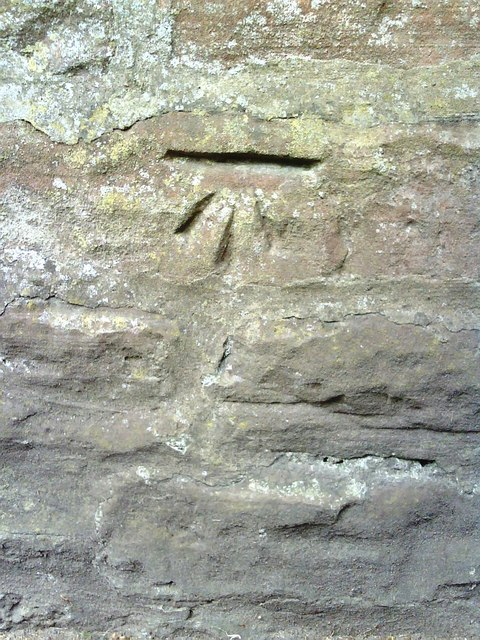 Benchmark on wall of Bongate
