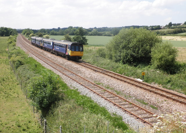 A train from Barnstaple passes Gunstone Mill