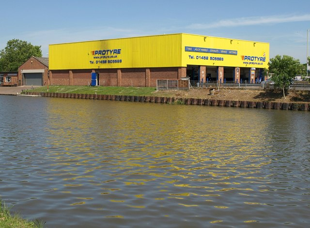 Tyre depot near Hempsted Bridge
