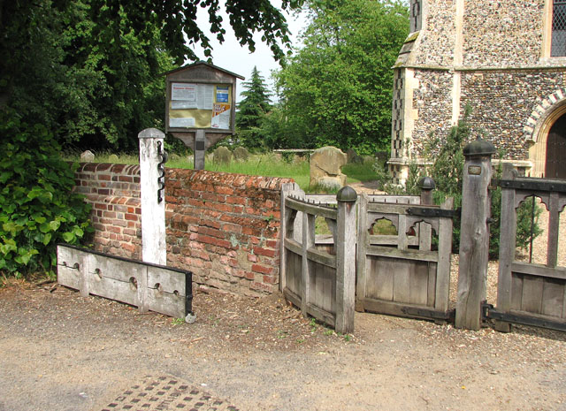 Stocks by the churchyard gate at St Mary's, Ufford