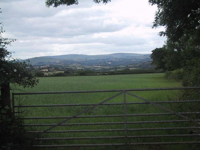 View of Dartmoor across a field