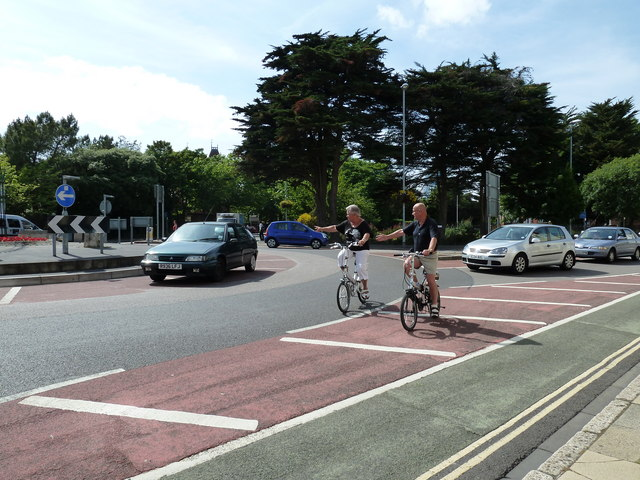 Cyclists heading round the King's Road Roundabout