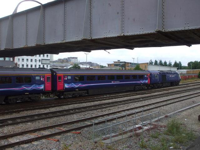 Train passing under  footbridge  in Cardiff
