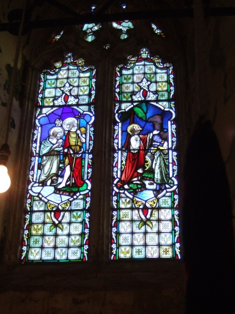 The window in the tower of Poughill church