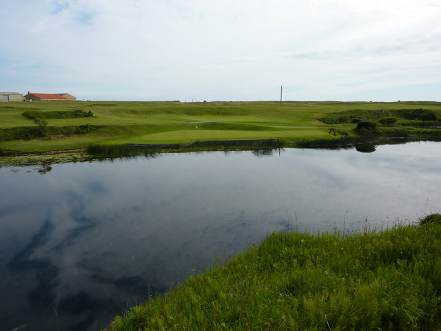 The 10th and 16th greens Seahouses Golf Course as viewed from the 10th tee
