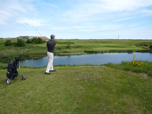 Playing the 10th Seahouses Golf Course