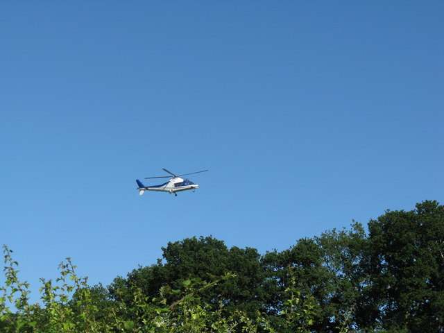 Helicopter over Smokyhouse Lane on approach to Polo ground
