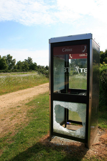 Phone box with broken glass