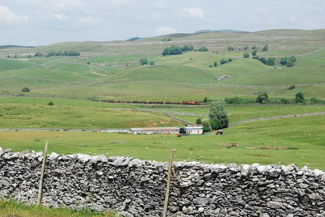 Farm buildings and a track maintenance train
