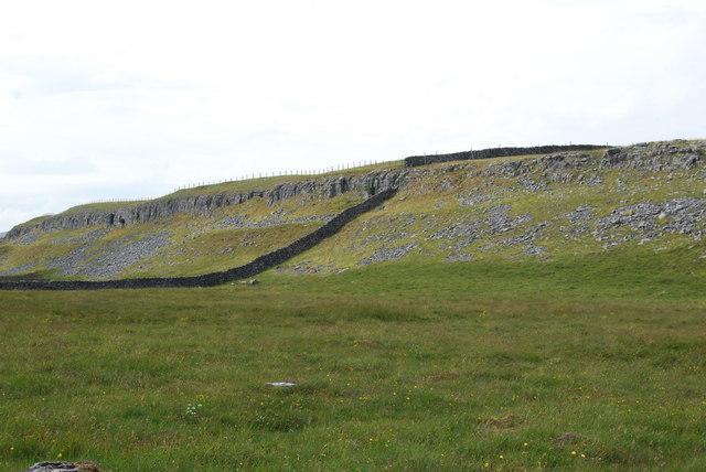 Stone dyke meets a limestone outcrop