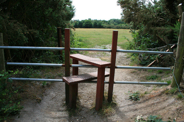 Stile to an open field
