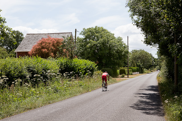 Cyclist passes Highwood Cottage