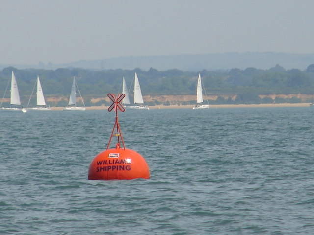 Williams Shipping orange racing buoy and foreshore