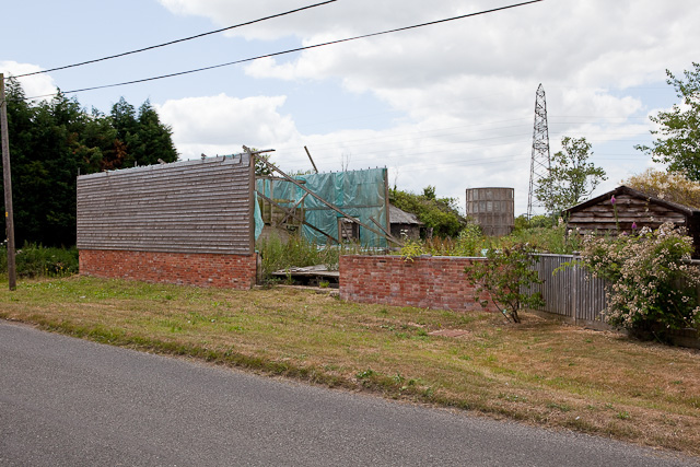 Disused buildings beside Highwood Farmhouse