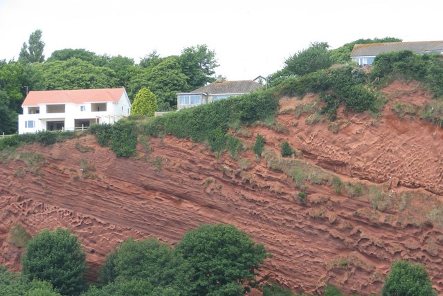 Houses close to the clifftop at Holcombe