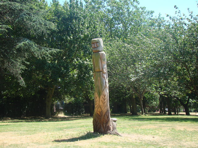 Wood-carved totem pole in Lodge Farm Park