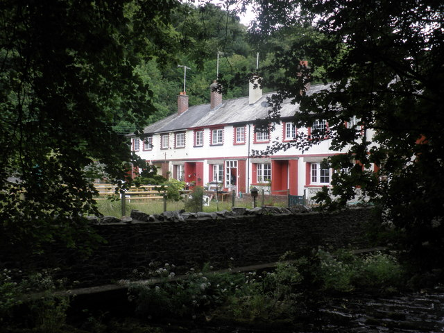 Terrace of houses, glimpsed from east of the river, at Okehampton