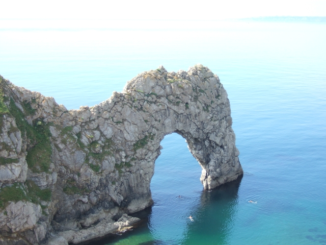 Swimmers under the arch of Durdle Door