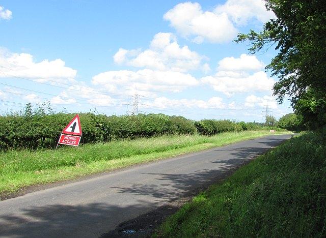 Minor road passing Dunglass Wood