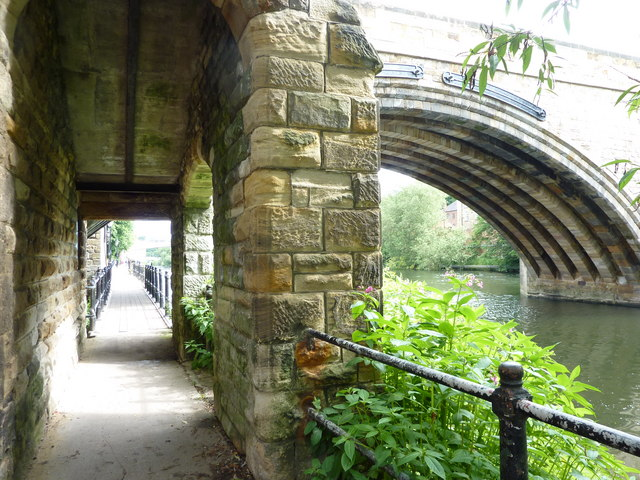 Footpath by the river Wear looking under Framwelgate Bridge.