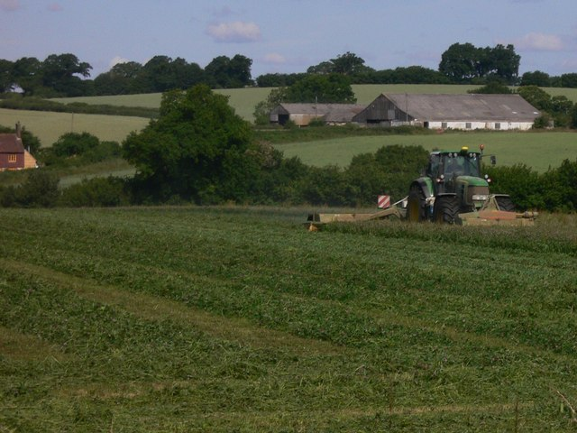 Tractor at work with Horley farm beyond