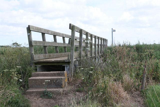 Footbridge running across small stream