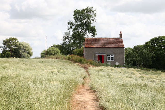 Footpath leading past small house