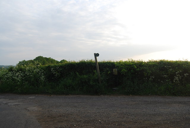 Leaning footpath sign, Charcott