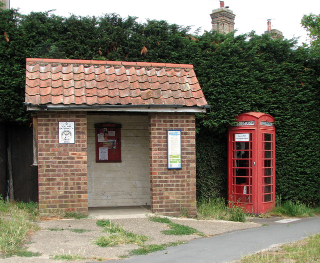 Bus shelter and K6 telephone box in The Street, North Cove