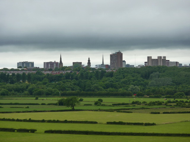 View over Fishwick Bottoms, with spires and towers, hoops plus the lamp standard