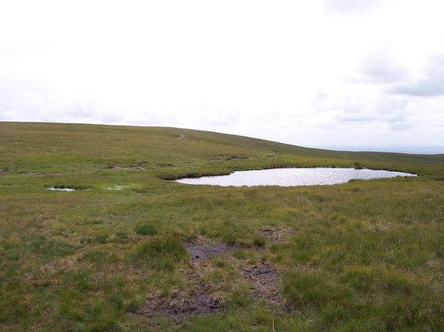Tarn near path to The Calf