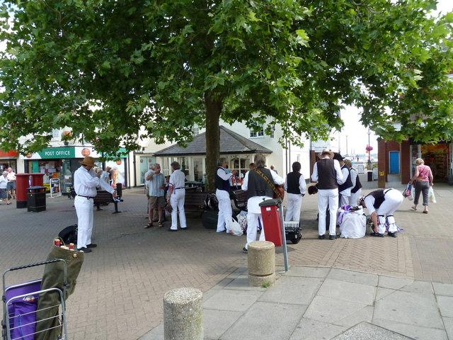 Morris Dancers preparing to perform in the High Street