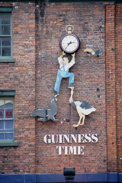 Clock above an Irish pub near Liverpool Central Station