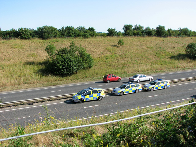 Police cars parked on the A47 road