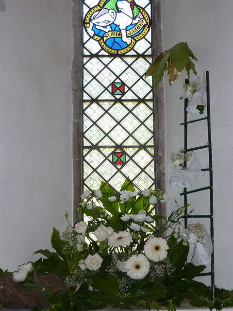 Flower display in a north window in Davington church