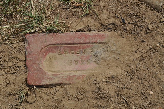 Star brick, made in Newport, buried in the track