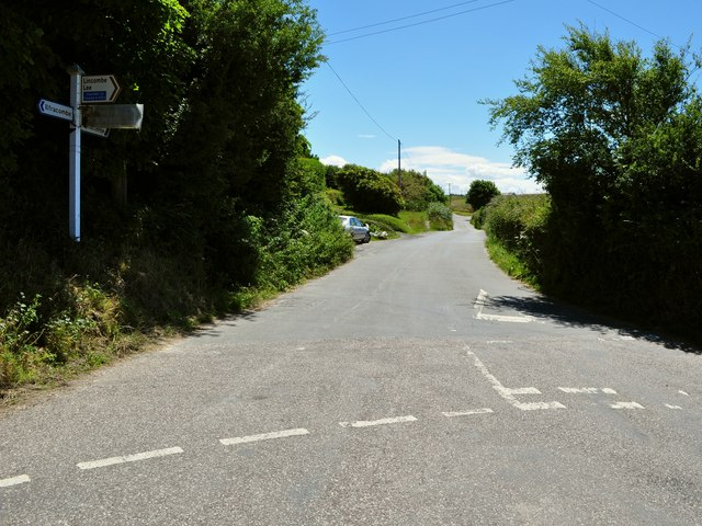 The road to Lee Cross leaves a road junction at Lincombe