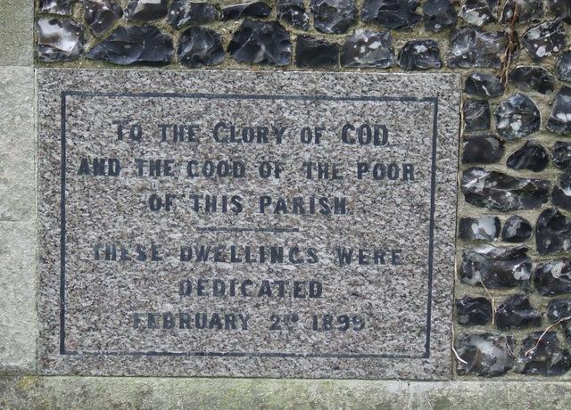 Dedication stone on the side of parish houses