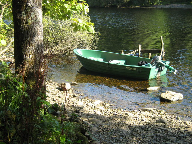 Boat beside small island in Loch Awe, Argyll