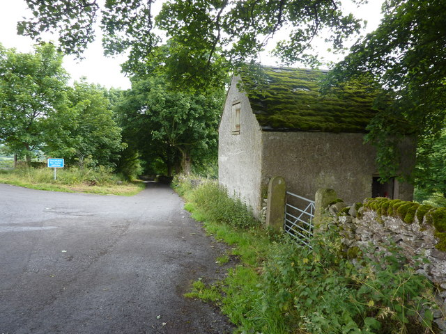 Barn at junction of two lanes