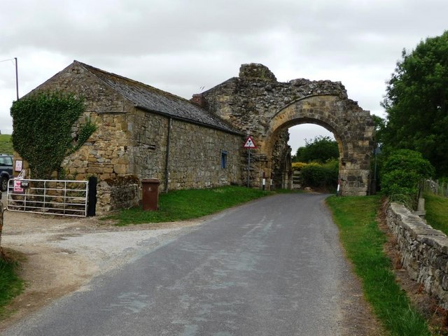Ruined medieval gatehouse arch